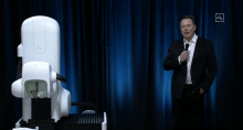elon musk with surgical robot for neuralink (1)